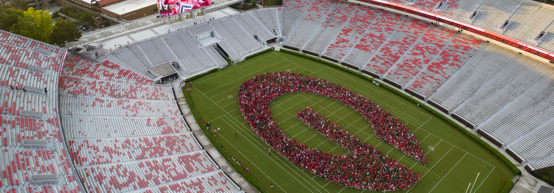UGA - Sanford Stadium with students forming the letter g on the field