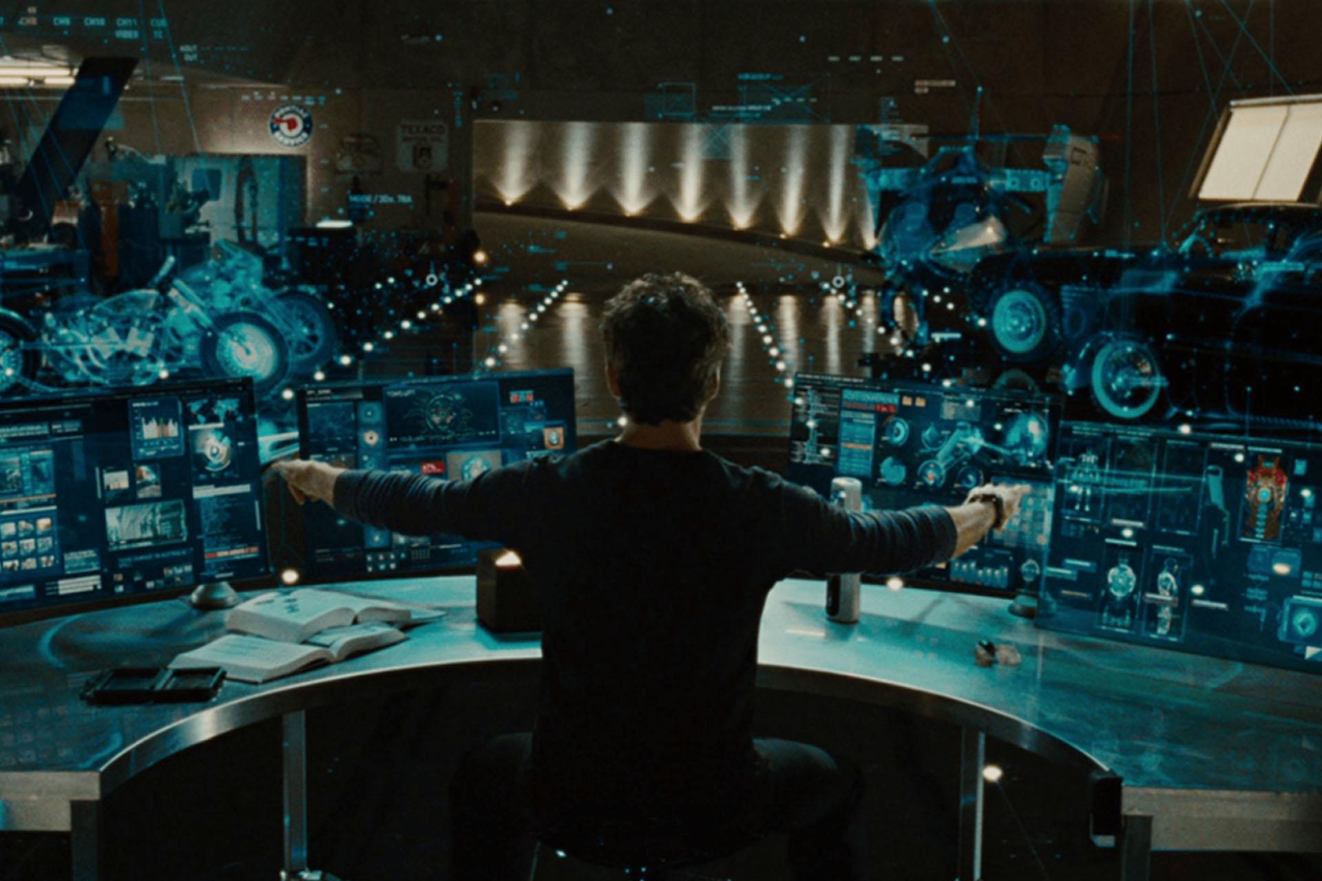 Man using multiple computer screens